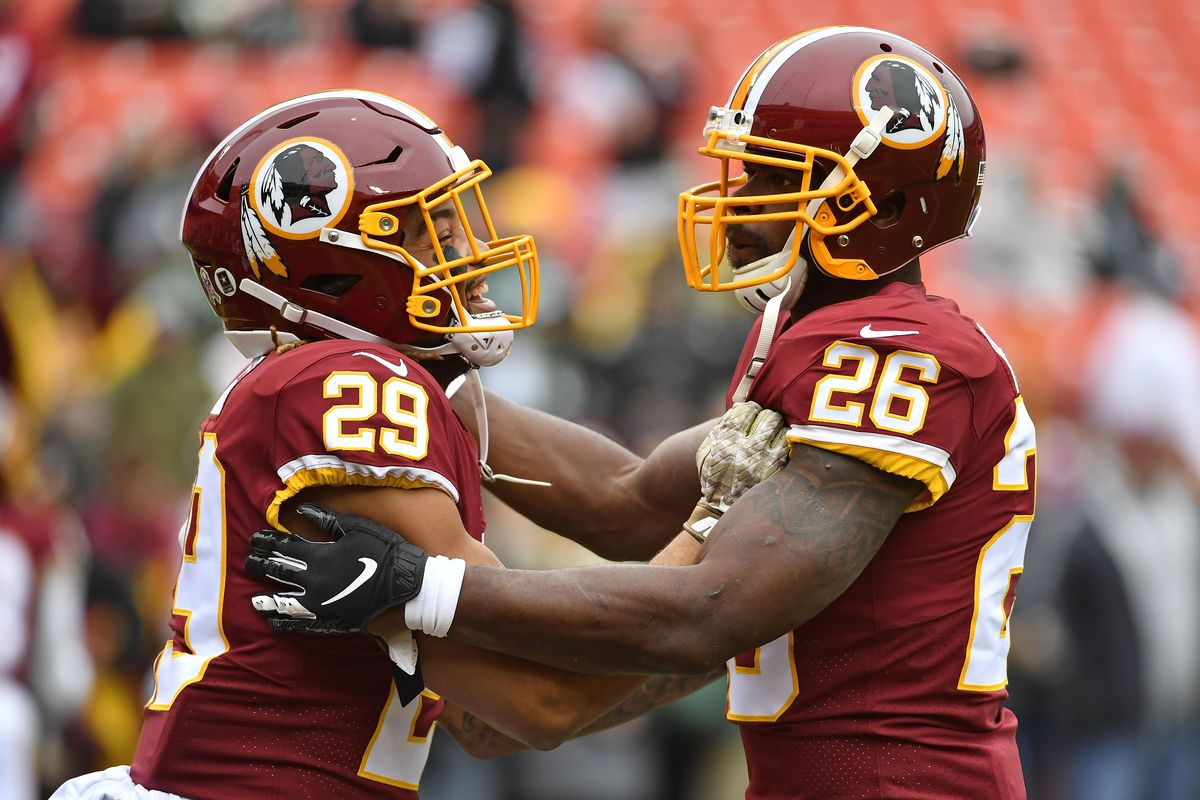 Washington Redskins running back Derrius Guice and running back Adrian Peterson warm up before the game between the Washington Redskins and the New York Jets at FedExField.