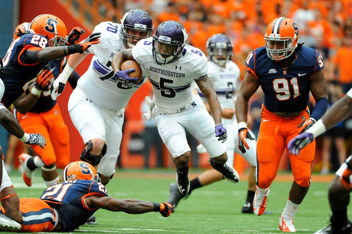 Sep 1, 2012; Syracuse, NY, USA; Northwestern Wildcats running back Venric Mark (5) runs with the ball during the first quarter against the Syracuse Orange at the Carrier Dome. Mandatory Credit: Rich Barnes-US PRESSWIRE
