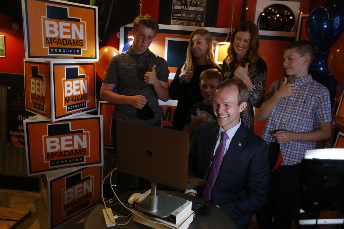 Rep. Ben McAdams, D-Utah, is interviewed over Zoom with his family, son James, left, daughter Kate, son Isaac, wife Julie, and son Robert, at Pat's Barbecue in Salt Lake City on election night, Tuesday, Nov. 3, 2020. McAdams is trying to win a second term and is being challenged by Republican Burgess Owens.