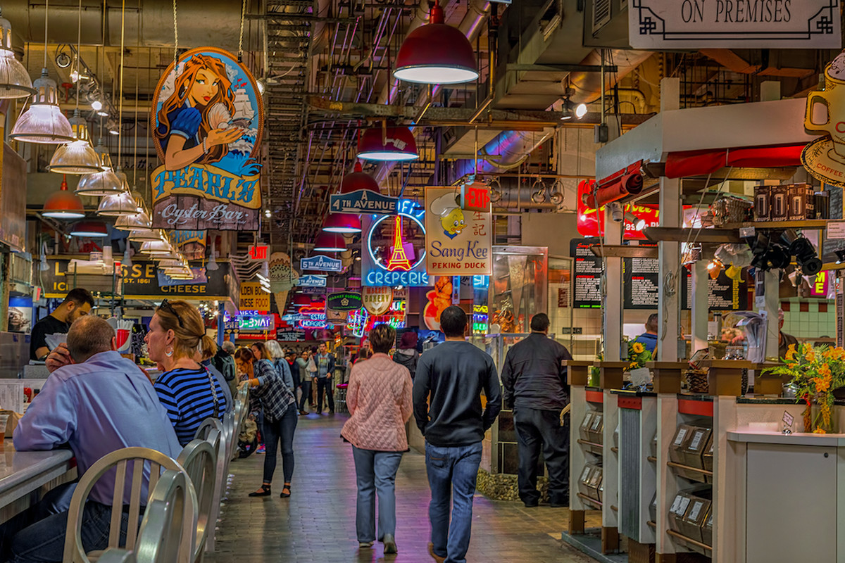 crowded food market with neon signs