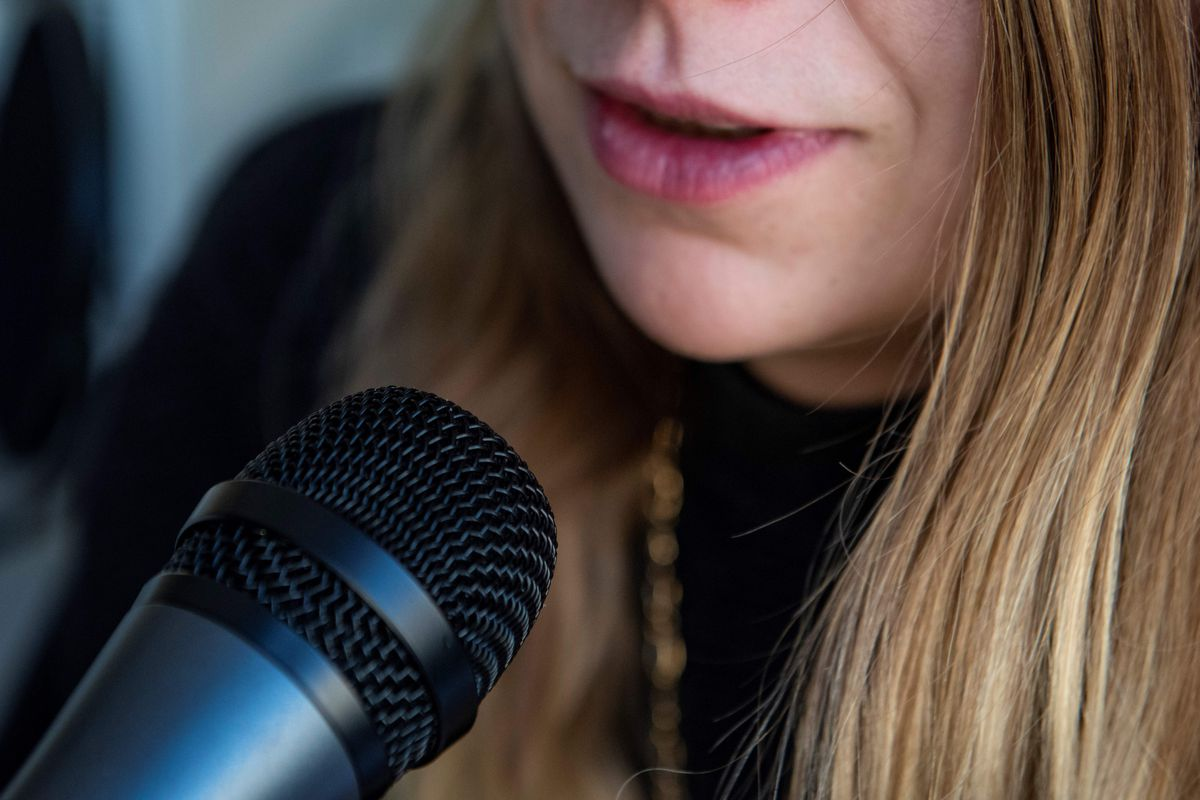 A journalist talks into a microphone on March 12, 2019 in Washington.