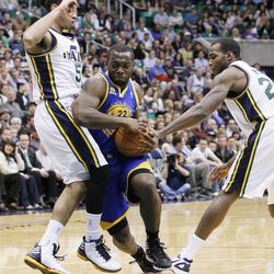 Golden State Warriors guard Charles Jenkins (22) attempts to drive past Utah Jazz point guard Devin Harris (5) and Utah Jazz power forward Paul Millsap (24) during the first half of an NBA basketball game, Friday, April 6, 2012, in Salt Lake City.  (AP Photo/Colin E Braley)