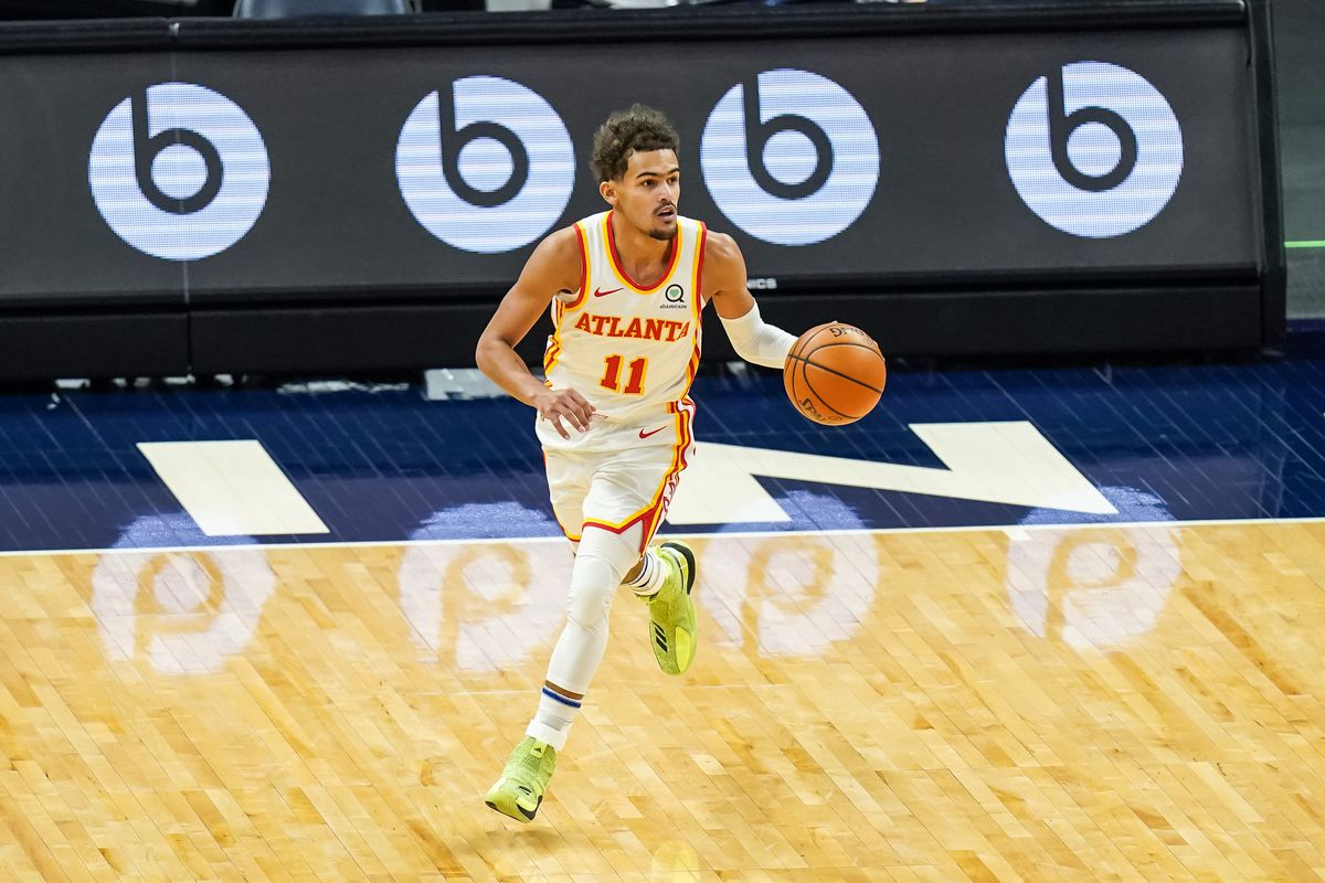 Atlanta Hawks guard Trae Young (11) dribbles during the first quarter against the Minnesota Timberwolves at Target Center.