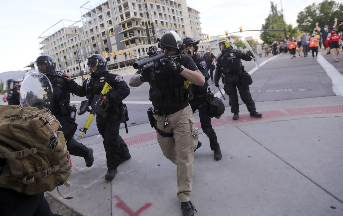 Police fire rubber bullets as they clash with protesters trying to enforce a curfew and clear the protesters out of downtown Salt Lake City on Monday, June 1, 2020. Recent protests against police brutality, racial discrimination and the killing of George Floyd turned violent in Salt Lake City and other cities across the nation, prompting Gov. Gary Herbert to call in the Utah National Guard.
