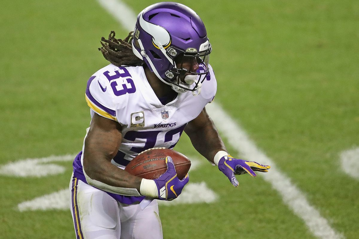 Dalvin Cook #33 of the Minnesota Vikings runs against the Chicago Bears at Soldier Field on November 16, 2020 in Chicago, Illinois. The Vikings defeated the Bears 19-13.
