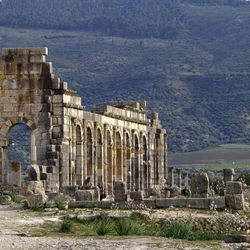 In this Thursday, March 8, 2012 photo, the afternoon sun shines on the arches of the Basilica, the main administrative building in the ancient Roman city of Volubilis, near Meknes, Morocco.