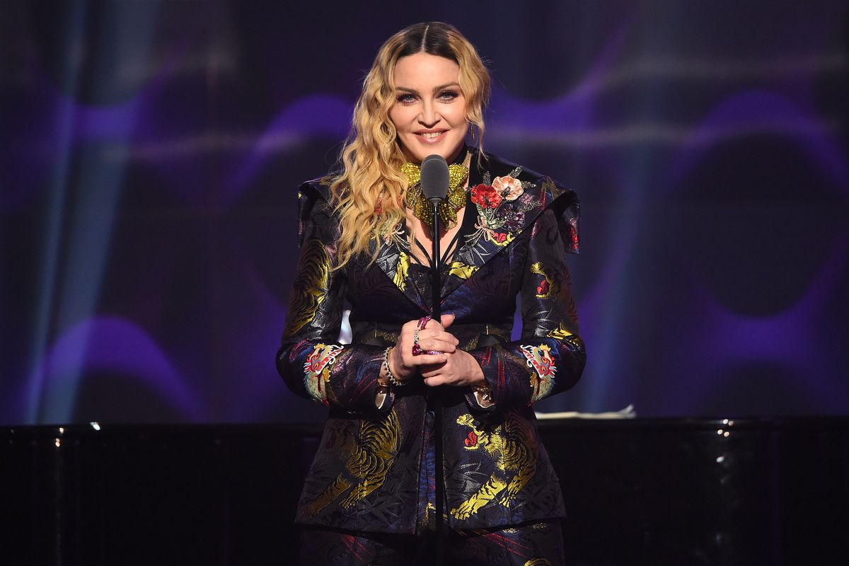 Madonna on stage in front of a microphone