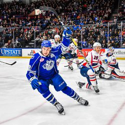 Syracuse Crunch Ross Colton (22) celebrates his goal against the Springfield Thunderbirds in American Hockey League (AHL) action at the War Memorial Arena in Syracuse, New York on Saturday, December 29, 2018. Syracuse won 4-3 in OT.