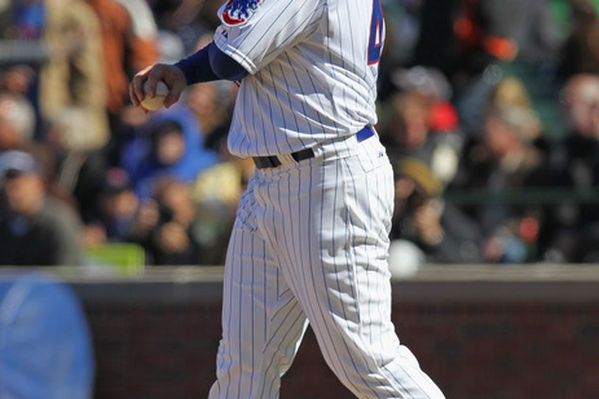 Ryan Dempster of the Chicago Cubs walks back to the mound after giving up a two-run home run to George Kottaras of the Milwaukee Brewers at Wrigley Field in Chicago, Illinois. (Photo by Jonathan Daniel/Getty Images)