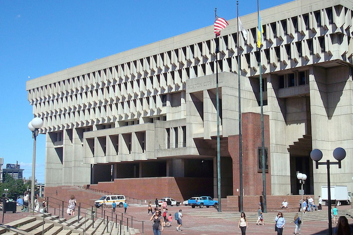 """Built in 1968, the Boston City Hall is no stranger to the title of """"<a href=""""http://www.boston.com/news/local/articles/2008/11/15/city_hall_picked_one_of_worlds_ugliest_buildings/"""">World's Ugliest Building</a>.""""—Photo via <a href=""""https://www.flickr"""