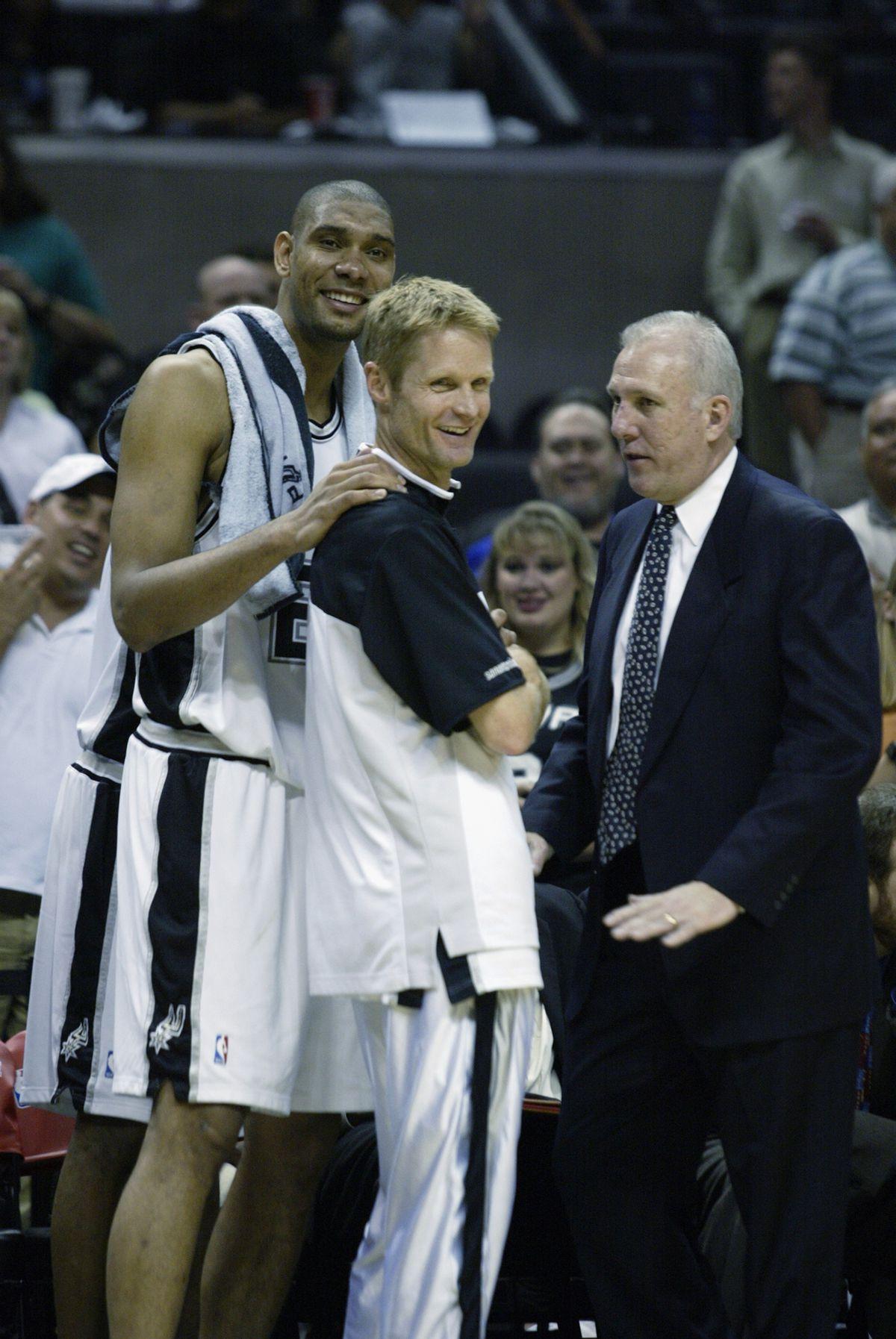 Duncan, Kerr and coach Popovich celebrate