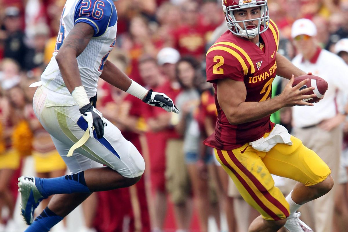 September 1, 2012; Ames, IA, USA;  Iowa State Cyclones wide receiver  Josh Lenz (19)  avoids the tackle by Tulsa Golden Hurricanes cornerback  Dexter McCoil (26) in the first half at Jack Trice Stadium. Mandatory Credit: Reese Strickland-US PRESSWIRE