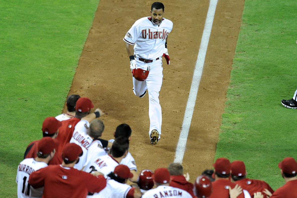 PHOENIX, AZ - AUGUST 11: Chris Young #24 of the Arizona Diamondbacks and teammates celebrate his walk off home run against the Houston Astros at Chase Field on August 11, 2011 in Phoenix, Arizona. Arizona won 8-5. (Photo by Norm Hall/Getty Images)