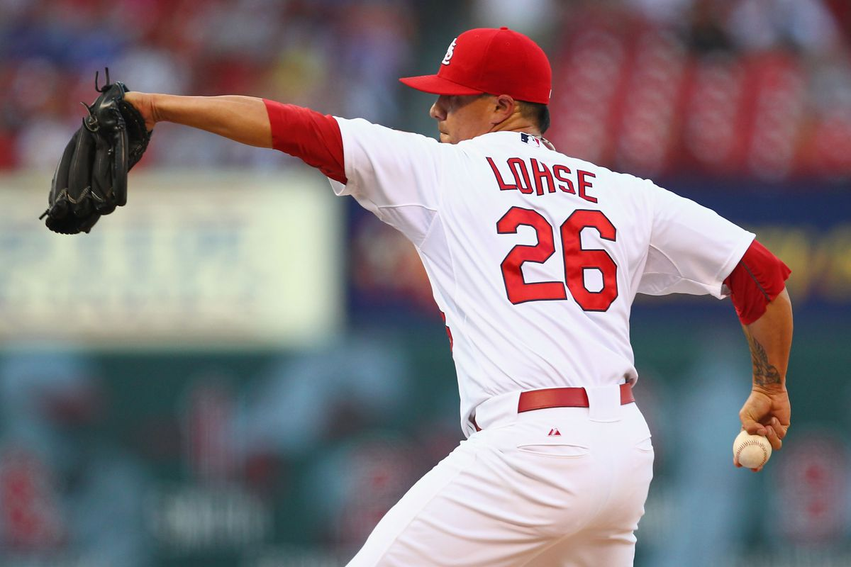 ST. LOUIS, MO - JULY 25: Starter Kyle Lohse #26 of the St. Louis Cardinals pitches against the Los Angeles Dodgers at Busch Stadium on July 25, 2012 in St. Louis, Missouri.  (Photo by Dilip Vishwanat/Getty Images)