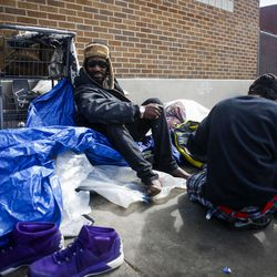 """""""Preach"""" sits on the sidewalk outside the Catholic Community Services (200 S. and 500 W.) next to the Road Home, called """"The Block,"""" with Criss in Salt Lake City on Wednesday, March 8, 2017."""