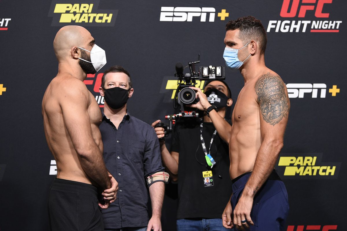 Opponents Omari Akhmedov of Russia and Chris Weidman face off during the UFC Fight Night weigh-in at UFC APEX on August 07, 2020 in Las Vegas, Nevada.