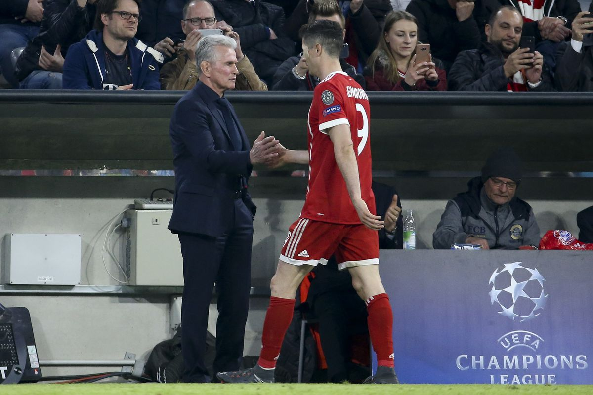 MUNICH, GERMANY - APRIL 11: Coach of Bayern Munich Jupp Heynckes greets Robert Lewandowski after he's replaced during the UEFA Champions League Quarter Final second leg match between Bayern Muenchen and FC Sevilla at Allianz Arena on April 11, 2018 in Munich, Germany.