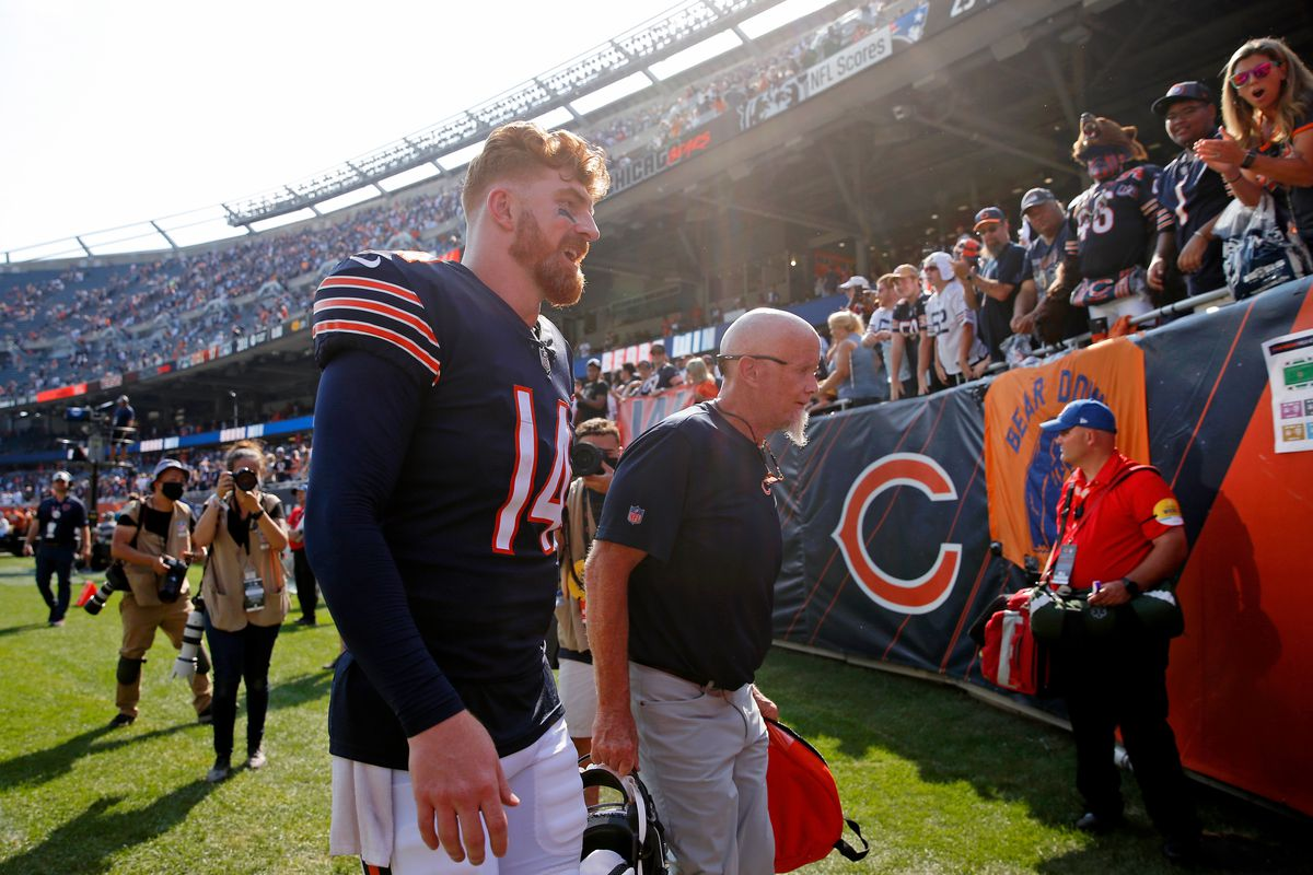 Sep 19, 2021; Chicago, Illinois, USA; Chicago Bears quarterback Andy Dalton (14) walks off the field after their 20-17 win over the Cincinnati Bengals at Soldier Field.
