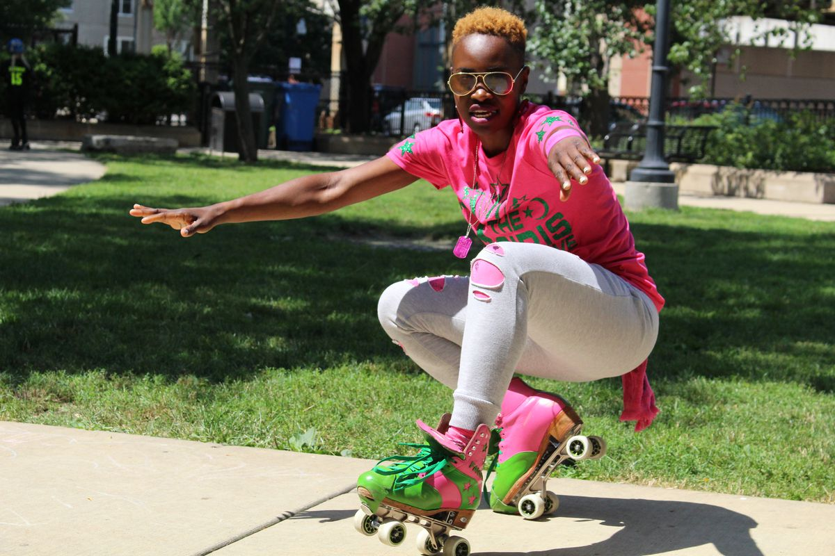 Myesha McCaskill, from the Osiris Initiative, freestyle skates at the roller derby birthday celebration.  Emily Moon/Sun-Times