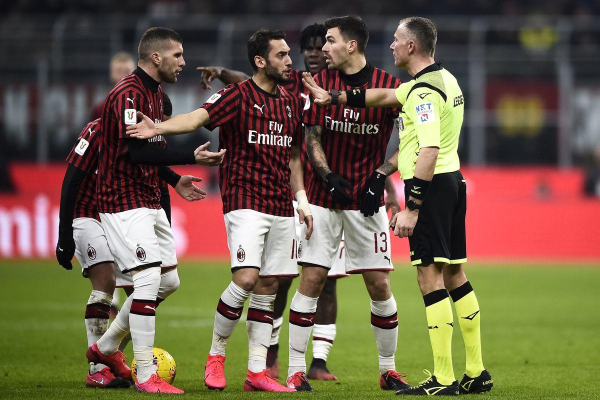 Players of AC Milan (L-R: Ante Rebic, Hakan Calhanoglu,...