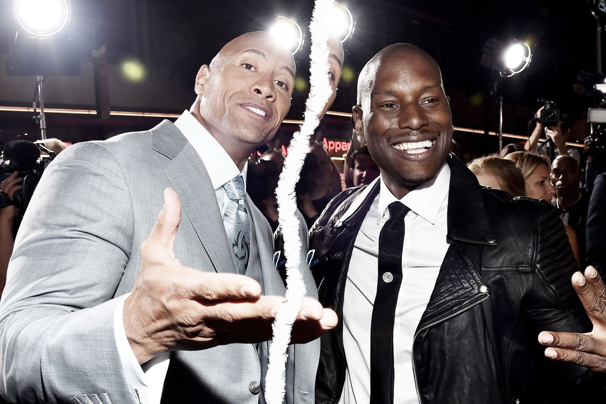 """Dwayne """"The Rock"""" Johnson and Tyrese Gibson smiling"""