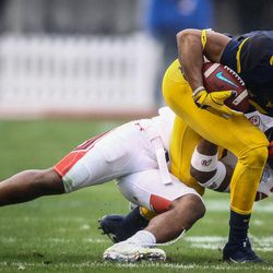 West Virginia Mountaineers wide receiver Ka'Raun White (2) is brought down by Utah Utes defensive back Javelin Guidry (28) at the Zaxby's Heart of Dallas Bowl between the Utah Utes and the West Virginia Mountaineers in Dallas Texas on Tuesday, Dec. 26, 2017.