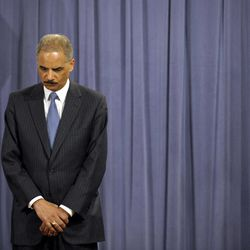Attorney General Eric Holder is seen at a news conference at the Justice Department in Washington, Wednesday, April 11, 2012. The Justice Department and several states have sued Apple Inc. and major book publishers, alleging a conspiracy to raise the price of electronic books that Attorney General Eric Holder says cost consumers millions of dollars.