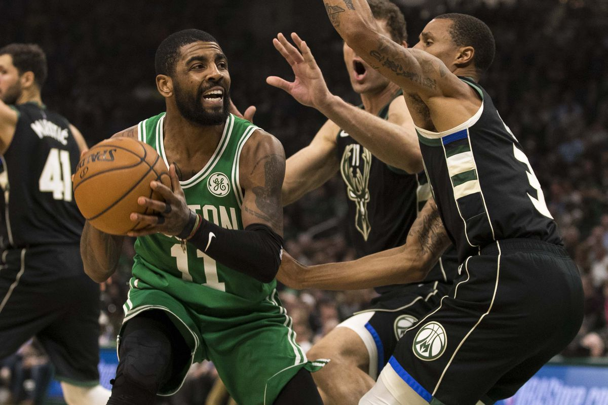 Kyrie Irving trying to get a shot off against the Milwaukee Bucks