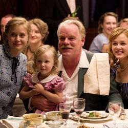 """This film image released by The Weinstein Company shows Amy Adams, left, and Philip Seymour Hoffman, center, in a scene from """"The Master.""""  The film will be presented at the 37th Toronto International Film festival running through Sept. 16."""