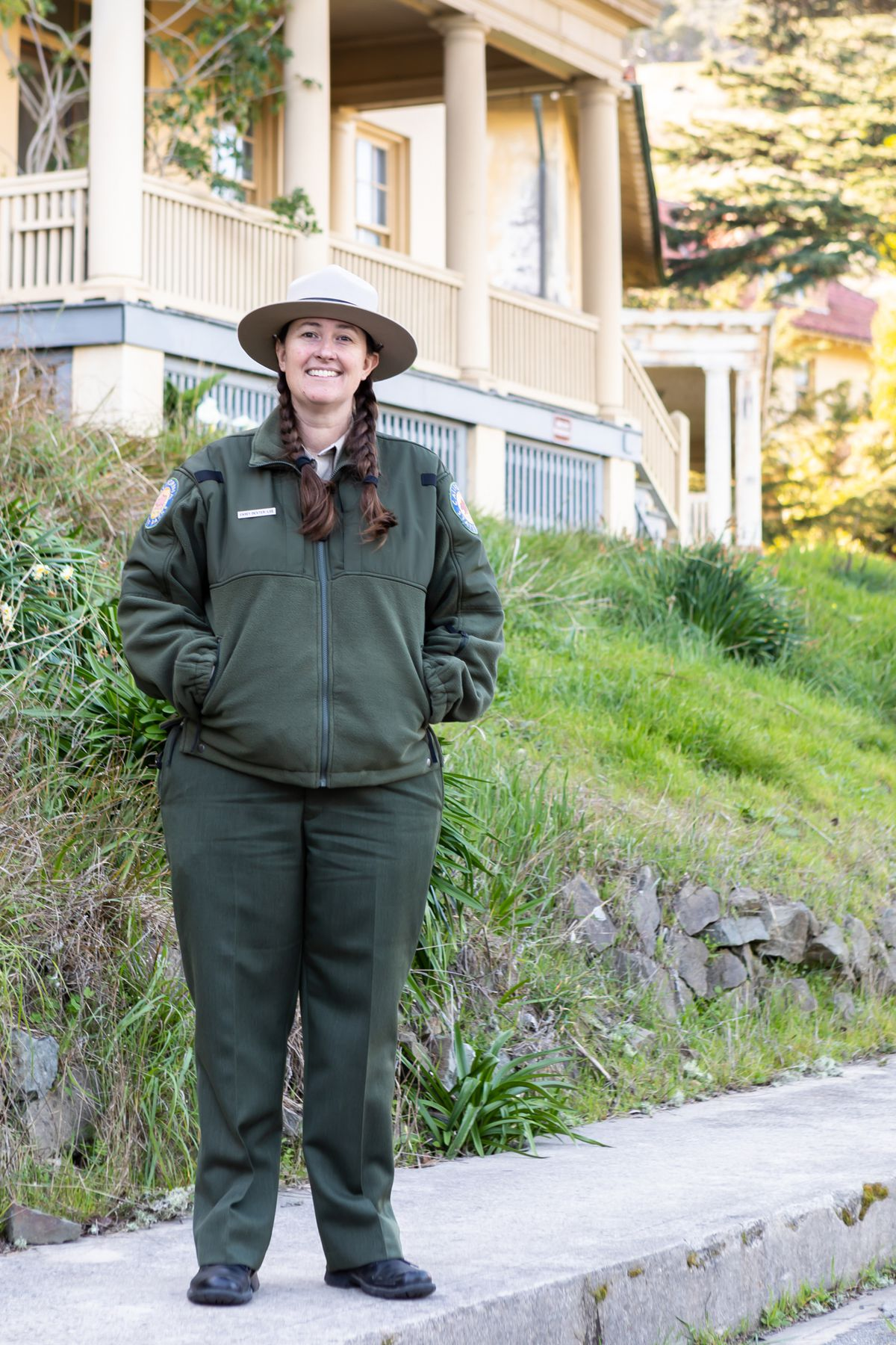 A woman with long braids. She's dressed in official ranger garb.