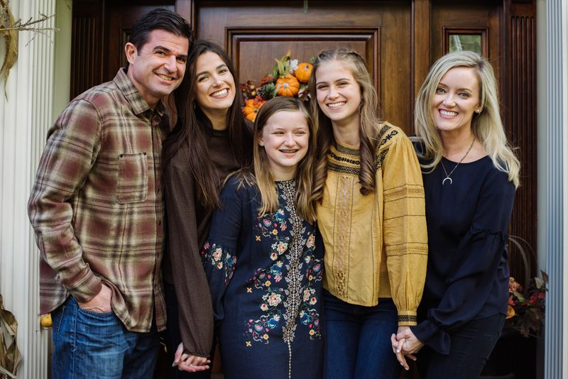 Scott and Lisa O'Neil, with daughters Alexa, Eliza and Kira, stand on the front steps of their home.