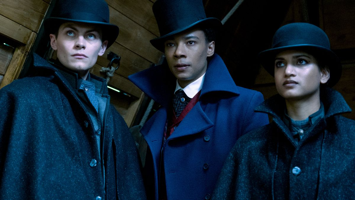 kaz, jesper, and inej in top hats in shadow and bone