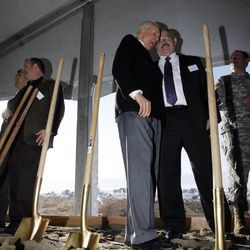 At right center, Sen. Orrin Hatch shares a laugh with Tom Bell, assistant deputy director for intelligence integration at the Office of the Director of National Intelligence, after they shovel some dirt during the groundbreaking for the first Intelligence Community Comprehensive National Cybersecurity Initiative (CNCI) Data Center at Camp Williams, Utah on Thursday, Jan. 6, 2011.