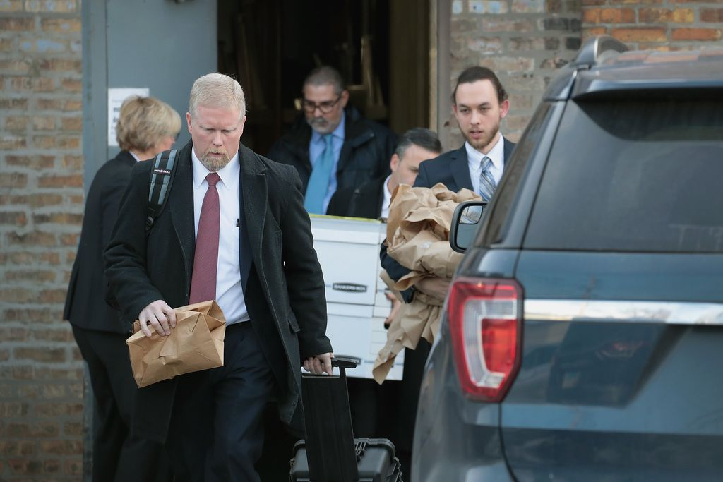 Federal agents remove computer equipment and document boxes from Burke's ward office.   Scott Olson/Getty Images