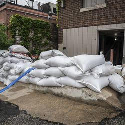 The DuPage River overflowed its banks and flooded portions of the Naperville Riverwalk Monday, May 18, 2020. A few businesses along the river started to prepare for the worst.