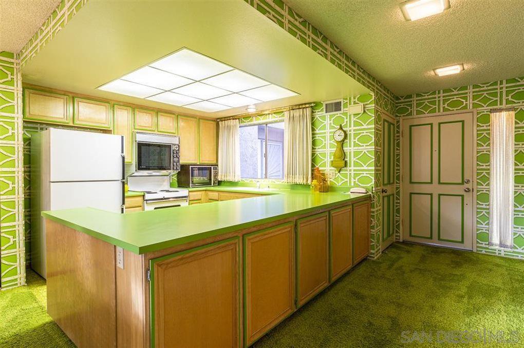 Green countertops in kitchen.