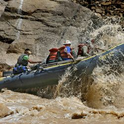 Brian Martinez guides his boat through the whitewater  on the Colorado River in Cataract Canyon in Southern Utah, July 28,  2008.