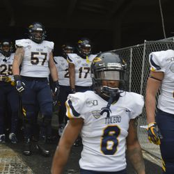 The Toledo football walk out of the tunnel to arrive at Kelly/Shorts.