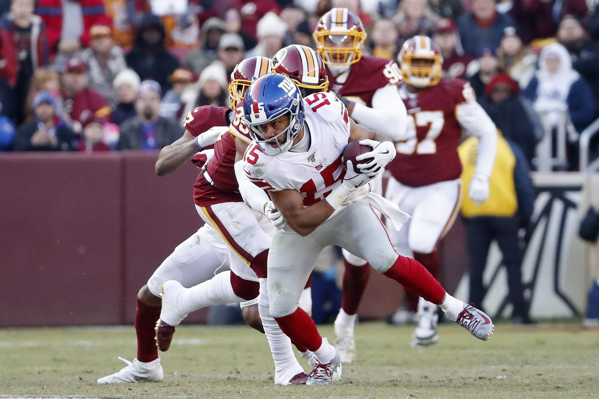New York Giants wide receiver Golden Tate runs with the ball past Washington Redskins free safety Montae Nicholson in the fourth quarter at FedExField.
