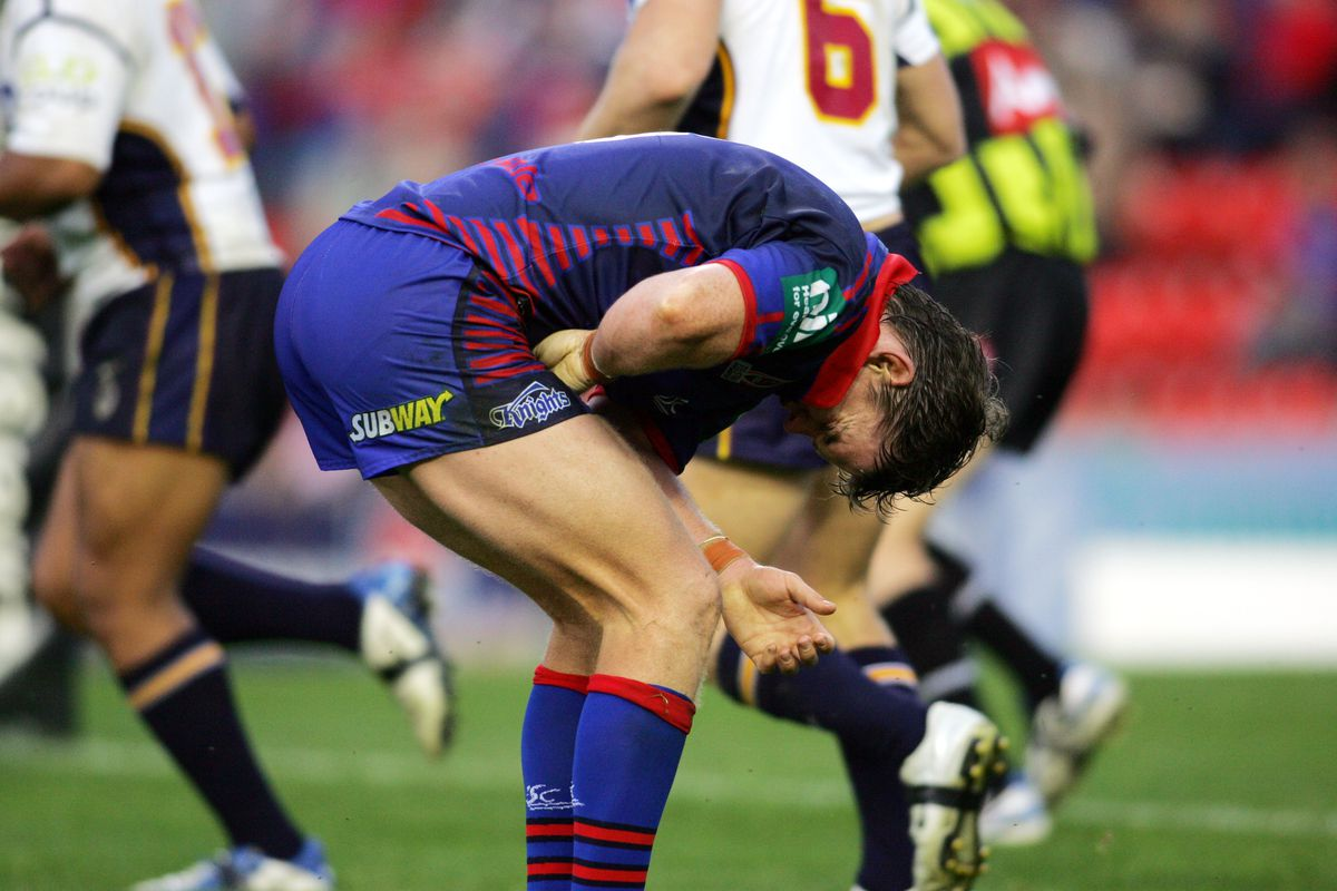 Newcastle Knights player Matt Gidley curls over in pain with a groin injury duri