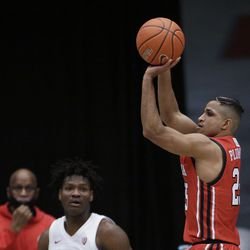 Utah guard Alfonso Plummer shoots next to Washington State center Efe Abogidi during the second half of an NCAA college basketball game in Pullman, Wash., Thursday, Jan. 21, 2021.