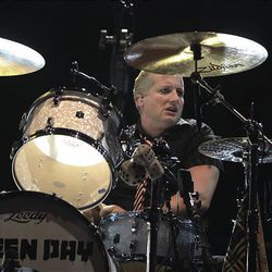 Green Day drummer Tre Cool performs at EnergySolutions Arena in Salt Lake City Sunday.