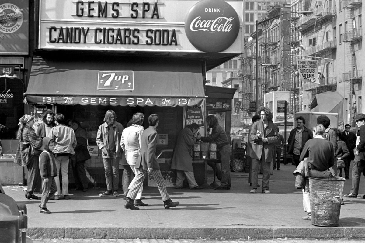 A black and white photo of a storefront saying Gem Spa
