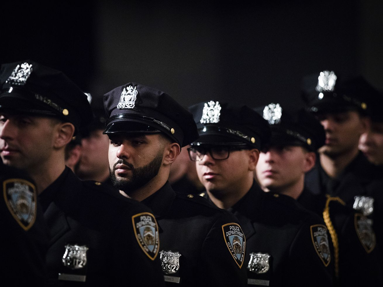 New York City Police Department officers standing in a line.