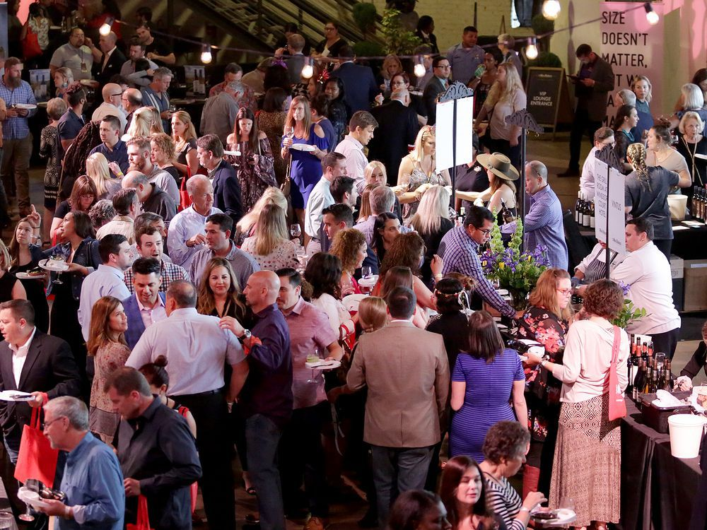A crowd of people gathered for The Grand Tasting event from last year's New Orleans Wine & Food Experience, now canceled in New Orleans