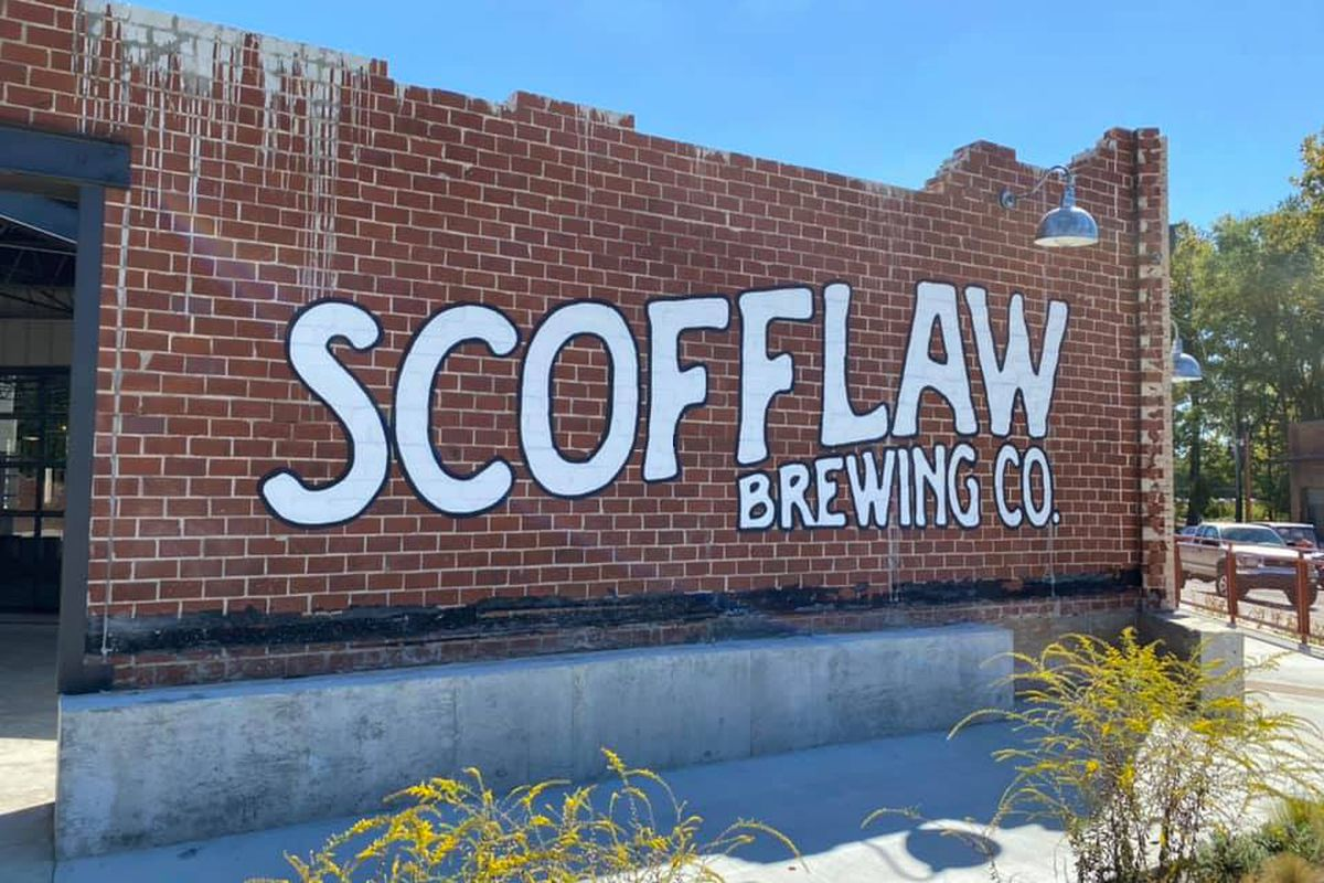 Logo for Scofflaw Brewing Co painted on the side of broken brick wall at the brewery's second location at the Works on Chattahoochee Avenue