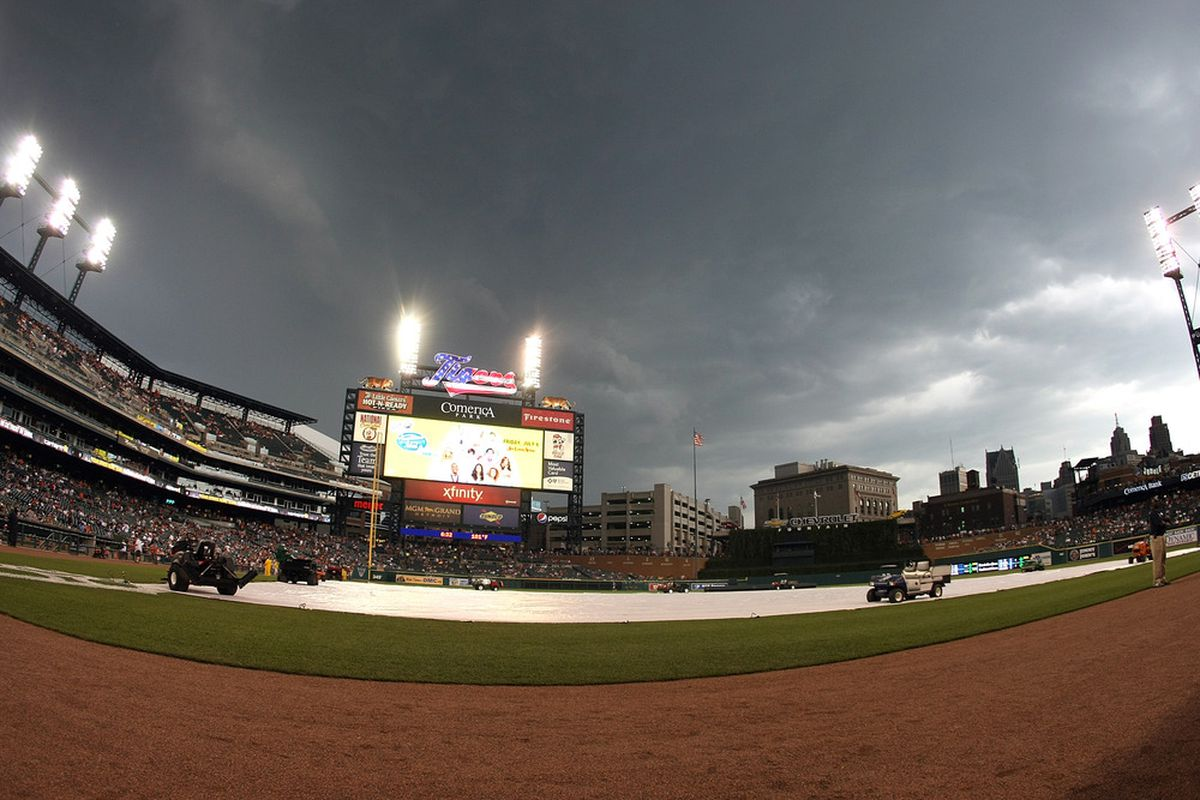 DETROIT, MI - JULY 04:  The infield is covered in anticapation of rain prior to the start of the MLB game between the Detroit Tigers and the Minnesota Twins at Comerica Park on July 4, 2012 in Detroit, Michigan.  (Photo by Dave Reginek/Getty Images)