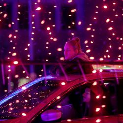 """Hanna Lloyd rides through """"Light the RioT,"""" a drive-thru light show, outside Rio Tinto Stadium in Sandy on Monday, May 4, 2020."""