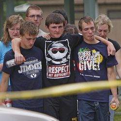 Family members console each other after Kalem Franco, 17, from Heber City, drowned while swimming toward the island in 55-degree water at Deer Creek Island Beach while on a family outing at Deer Creek Reservoir Wednesday, June 29, 2011, in Wasatch County near Heber City.
