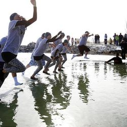 Team Walmart, from the Saratoga Springs store, jumps into the water to raise money for the Special Olympics.